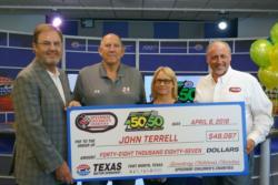 "From left: Texas Motor Speedway President Eddie Gossage, John Terrell, Carol Terrell and SCC-Texas Chapter President Carl ""Scooter"" Gierisch"